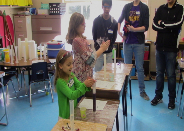 Young students having fun with science